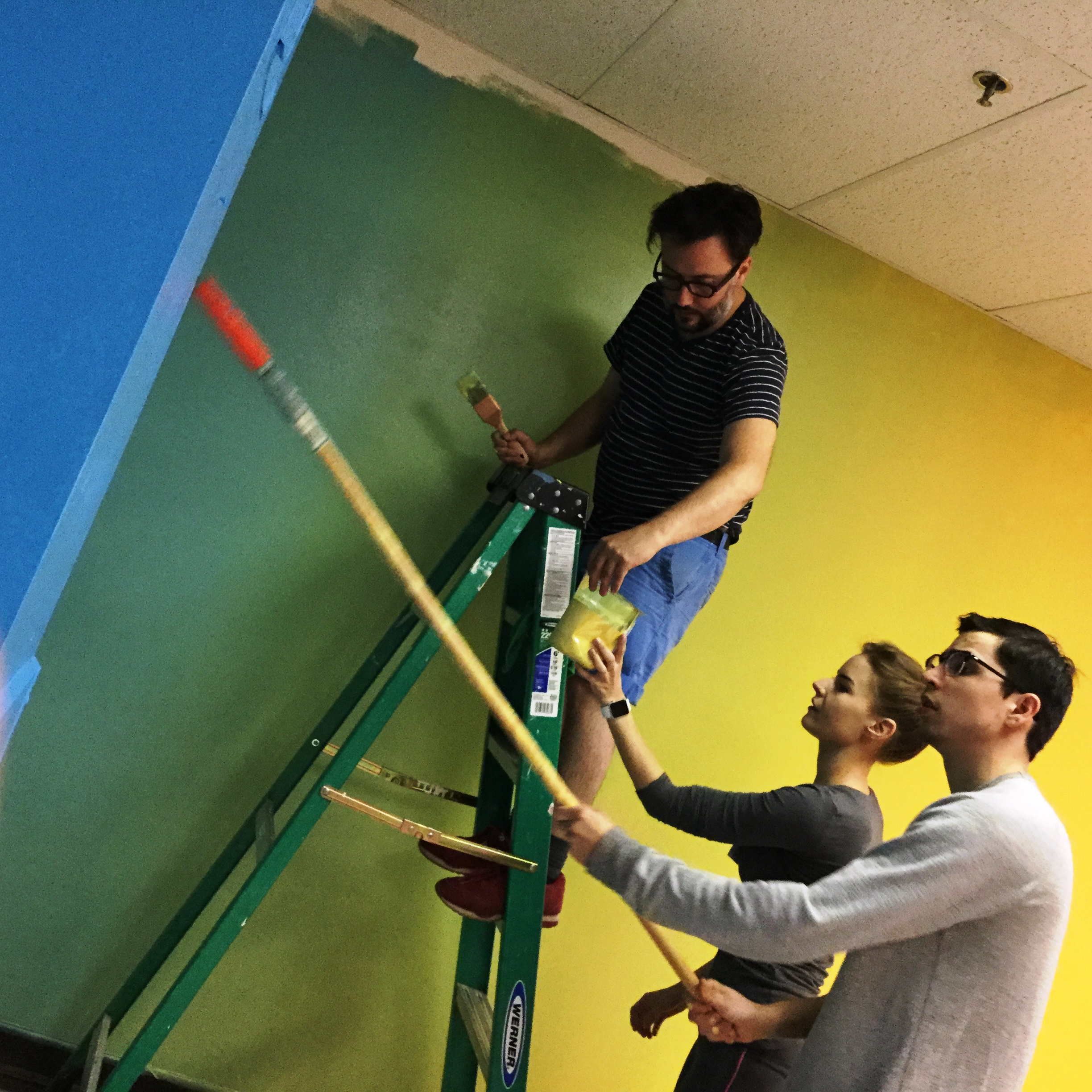 UMKC Students Paint Mural for Goodwill